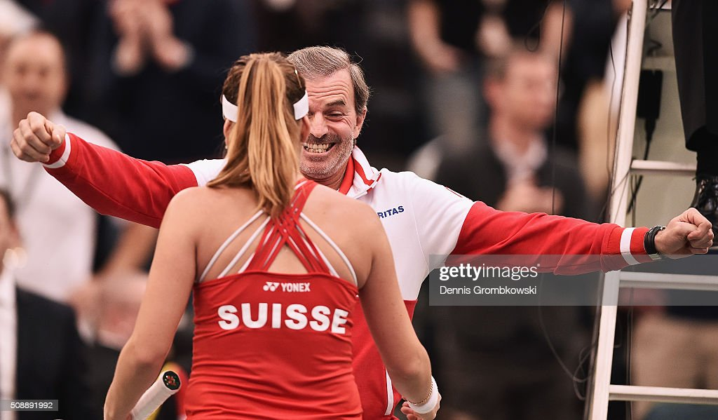 <a gi-track='captionPersonalityLinkClicked' href=/galleries/search?phrase=Belinda+Bencic&family=editorial&specificpeople=8837181 ng-click='$event.stopPropagation()'>Belinda Bencic</a> of Switzerland celebrates victory with team captain Heinz Guenthardt after her match against Angelique Kerber of Germany on Day 2 of the 2016 FedCup World Group Round 1 match between Germany and Switzerland at Messe Leipzig on February 7, 2016 in Leipzig, Germany.