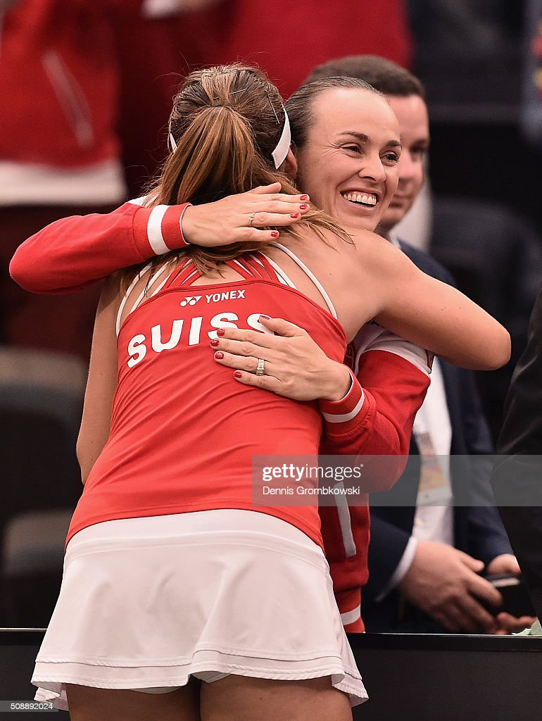 <a gi-track='captionPersonalityLinkClicked' href=/galleries/search?phrase=Belinda+Bencic&family=editorial&specificpeople=8837181 ng-click='$event.stopPropagation()'>Belinda Bencic</a> of Switzerland celebrates victory with team mate <a gi-track='captionPersonalityLinkClicked' href=/galleries/search?phrase=Martina+Hingis&family=editorial&specificpeople=202183 ng-click='$event.stopPropagation()'>Martina Hingis</a> after her match against Angelique Kerber of Germany on Day 2 of the 2016 FedCup World Group Round 1 match between Germany and Switzerland at Messe Leipzig on February 7, 2016 in Leipzig, Germany.