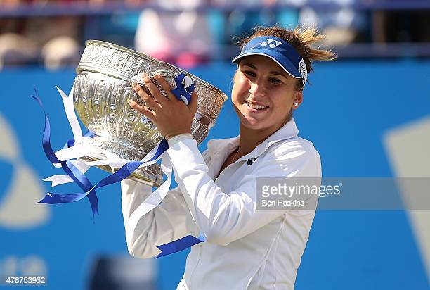 Belinda Bencic of Switzerland celebrates with the trophy after defeating Agnieszka Radwanska of Poland on day seven of the Aegon International at...