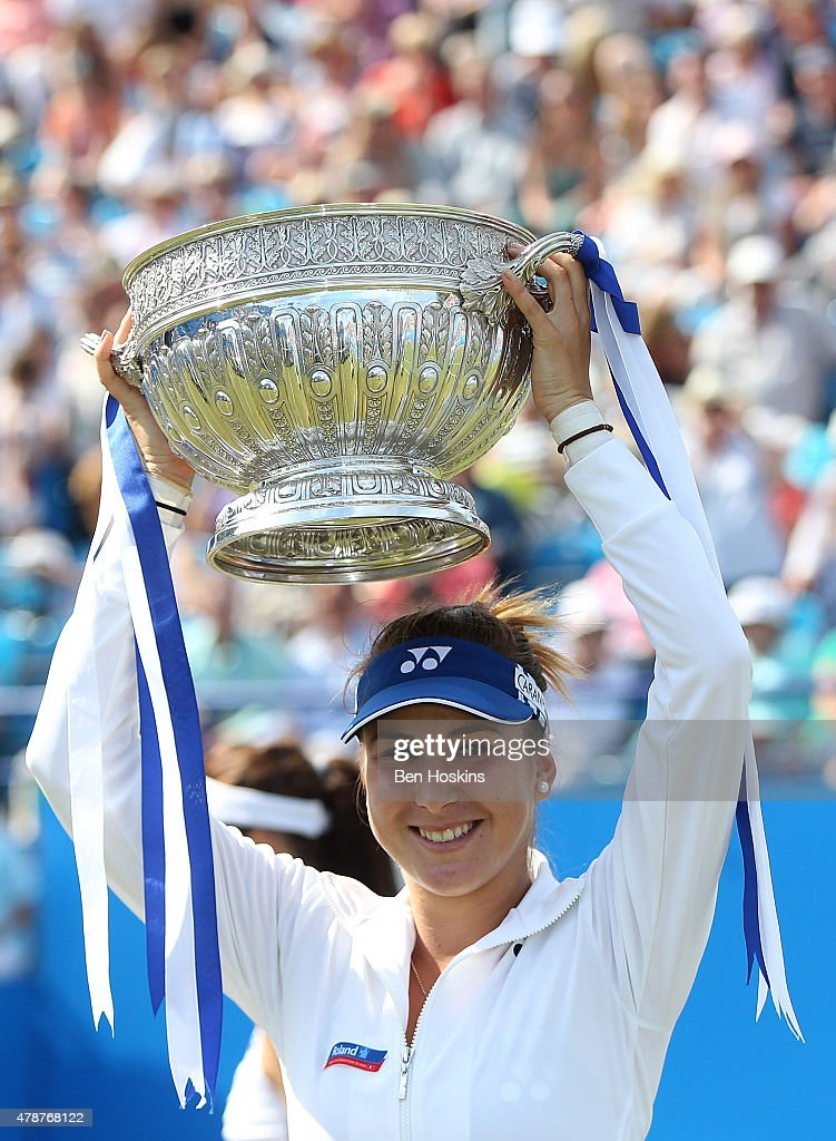 Belinda Bencic of Switzerland celebrates with the trophy after defeating Agnieszka Radwanska of Poland on day seven of the Aegon International at Devonshire Park on June 27, 2015 in Eastbourne, England.