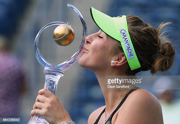 Belinda Bencic of Switzerland kisses the championship trophy after defeating Simona Halep of Romania during the finals match on Day 7 of the Rogers...