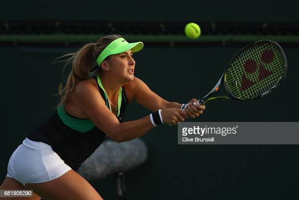 Belinda Bencic of Switzerland plays a backhand against Kiki Bertens of the Netherlands during their second round match on day five of the BNP Paribas...