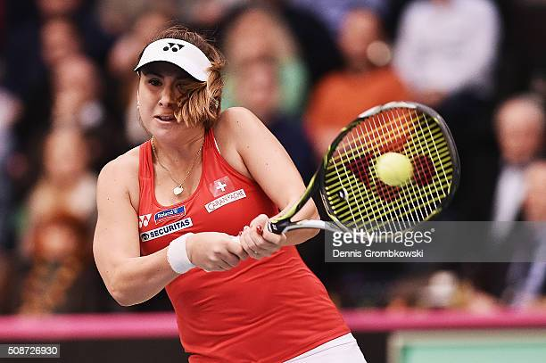 Belinda Bencic of Switzerland plays a backhand in her match against Andrea Petkovic of Germany during Day 1 of the 2016 Fed Cup World Group First...
