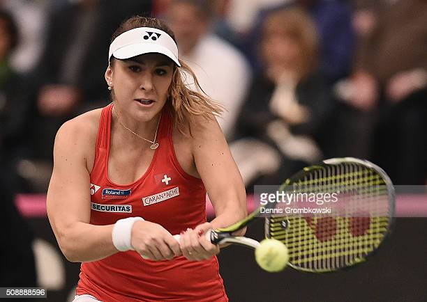 Belinda Bencic of Switzerland plays a backhand in her match against Angelique Kerber of Germany on Day 2 of the 2016 FedCup World Group Round 1 match...