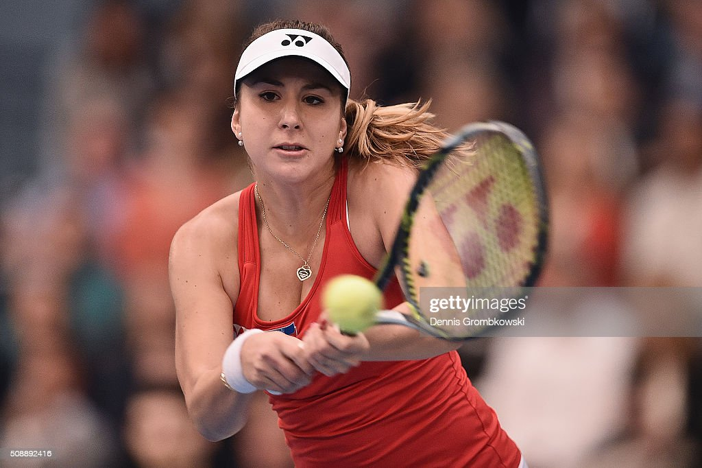 <a gi-track='captionPersonalityLinkClicked' href=/galleries/search?phrase=Belinda+Bencic&family=editorial&specificpeople=8837181 ng-click='$event.stopPropagation()'>Belinda Bencic</a> of Switzerland plays a backhand in her match against Angelique Kerber of Germany on Day 2 of the 2016 FedCup World Group Round 1 match between Germany and Switzerland at Messe Leipzig on February 7, 2016 in Leipzig, Germany.