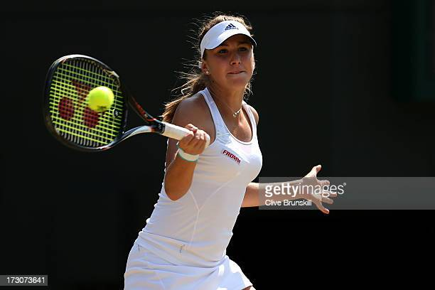 Belinda Bencic of Switzerland plays a forehand during the Girls' Singles final match against Taylor Townsend of the United States of America on day...