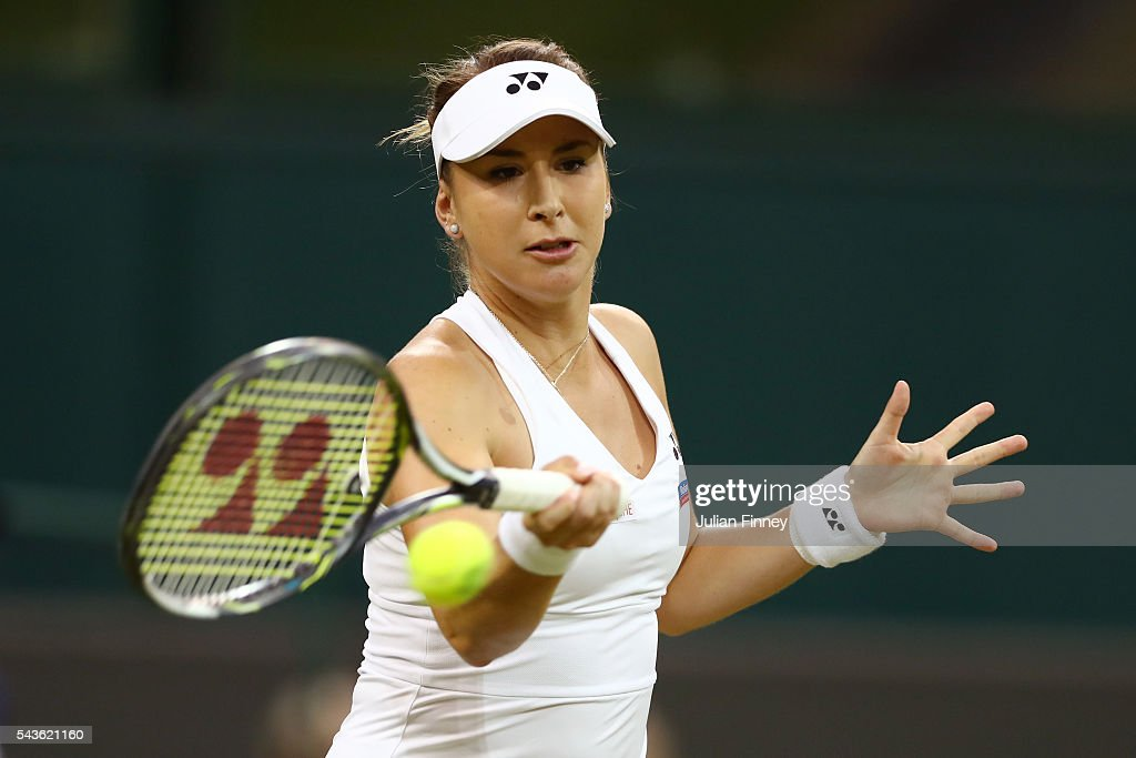 <a gi-track='captionPersonalityLinkClicked' href=/galleries/search?phrase=Belinda+Bencic&family=editorial&specificpeople=8837181 ng-click='$event.stopPropagation()'>Belinda Bencic</a> of Switzerland plays a forehand during the Ladies Singles second round match against Tsvetana Pironkova of Bulgaria on day three of the Wimbledon Lawn Tennis Championships at the All England Lawn Tennis and Croquet Club on June 29, 2016 in London, England.