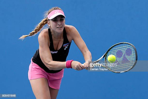 Belinda Bencic of Switzerland plays a forehand in her first round match against Alison Riske of the United States during day one of the 2016...