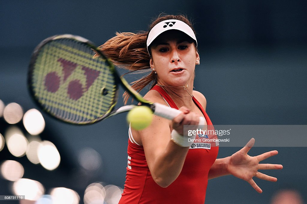 <a gi-track='captionPersonalityLinkClicked' href=/galleries/search?phrase=Belinda+Bencic&family=editorial&specificpeople=8837181 ng-click='$event.stopPropagation()'>Belinda Bencic</a> of Switzerland plays a forehand in her match against Andrea Petkovic of Germany during Day 1 of the 2016 Fed Cup World Group First Round match between Germany and Switzerland at Messe Leipzig on February 6, 2016 in Leipzig, Germany.