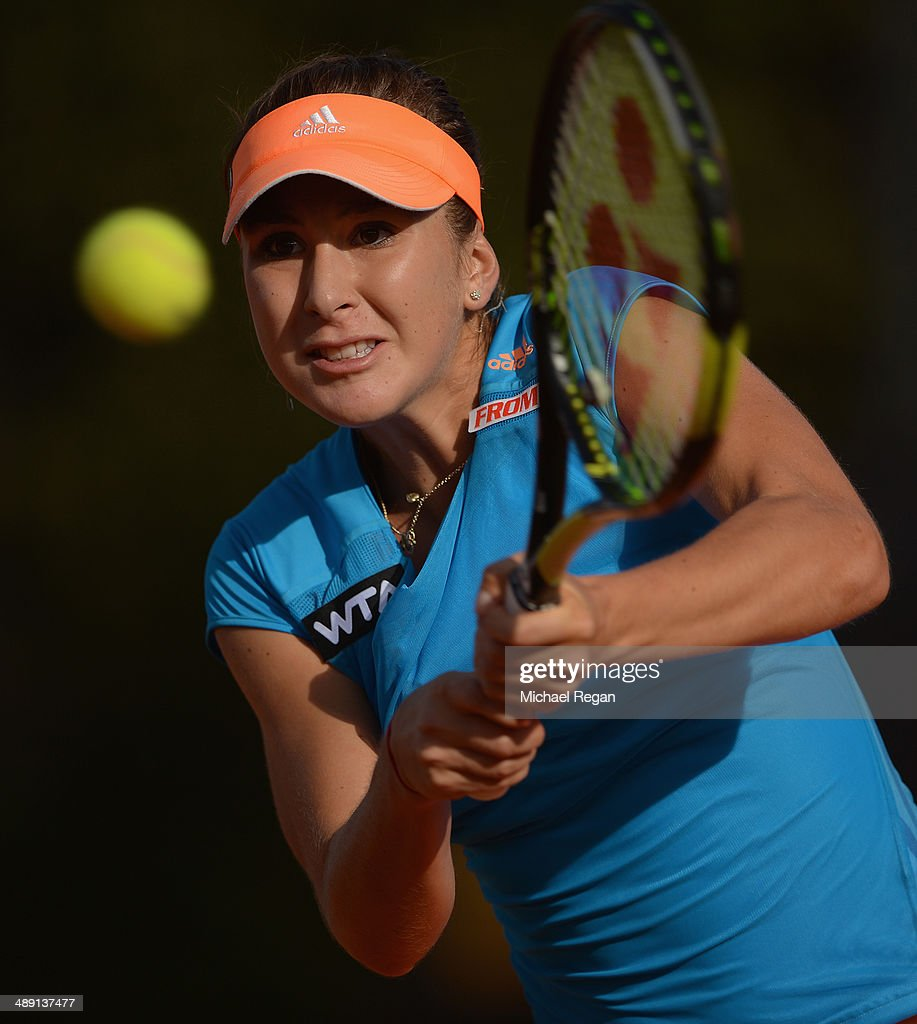 <a gi-track='captionPersonalityLinkClicked' href=/galleries/search?phrase=Belinda+Bencic&family=editorial&specificpeople=8837181 ng-click='$event.stopPropagation()'>Belinda Bencic</a> of Switzerland plays a shot against Polona Hercog of Slovenia during qualifying for the Internazionali BNL d'Italia 2014 on May 10, 2014 in Rome, Italy.