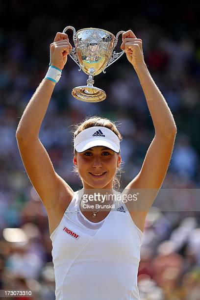 Belinda Bencic of Switzerland poses with the Girls' Singles trophy after the Girls' Singles final match against Taylor Townsend of the United States...
