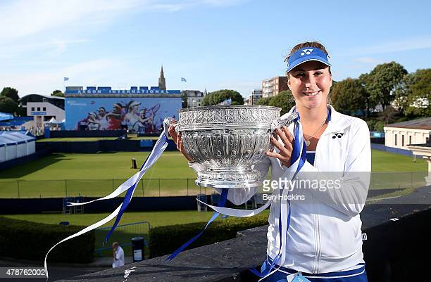 Belinda Bencic of Switzerland poses with the trophy after defeating Agnieszka Radwanska of Poland on day seven of the Aegon International at...