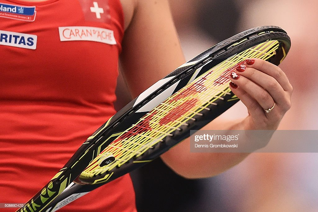 <a gi-track='captionPersonalityLinkClicked' href=/galleries/search?phrase=Belinda+Bencic&family=editorial&specificpeople=8837181 ng-click='$event.stopPropagation()'>Belinda Bencic</a> of Switzerland prepares to return in her match against Angelique Kerber of Germany on Day 2 of the 2016 FedCup World Group Round 1 match between Germany and Switzerland at Messe Leipzig on February 7, 2016 in Leipzig, Germany.