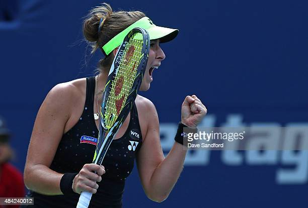 Belinda Bencic of Switzerland pumps her fist and yells after making a play against Simona Halep of Romania during the finals match on Day 7 of the...