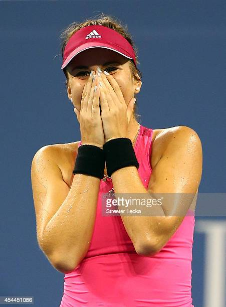 Belinda Bencic of Switzerland reacts after defeating Jelena Jankovic of Serbia during their women's singles fourth round match on Day Seven of the...
