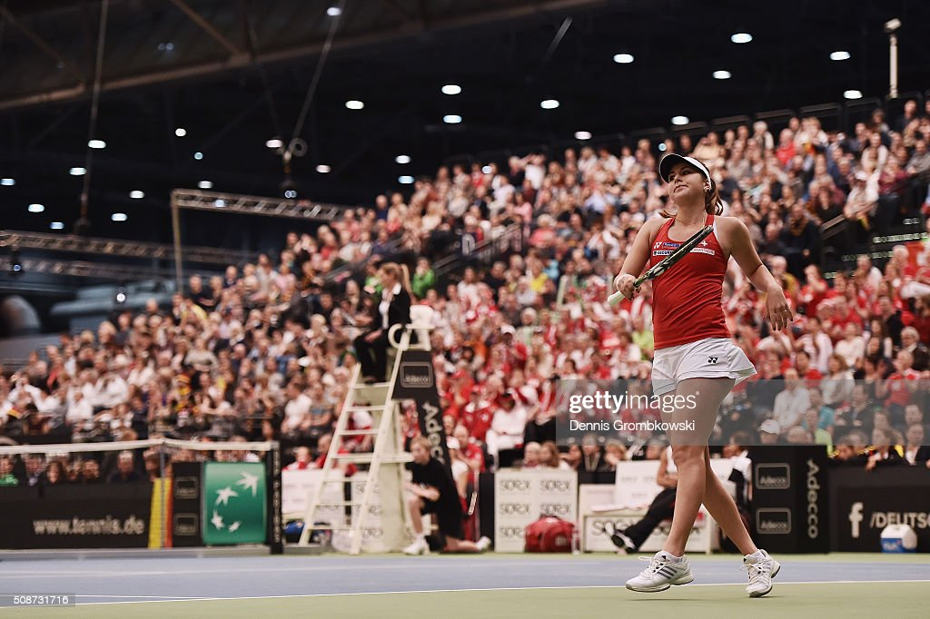 <a gi-track='captionPersonalityLinkClicked' href=/galleries/search?phrase=Belinda+Bencic&family=editorial&specificpeople=8837181 ng-click='$event.stopPropagation()'>Belinda Bencic</a> of Switzerland reacts during her match against Andrea Petkovic of Germany during Day 1 of the 2016 Fed Cup World Group First Round match between Germany and Switzerland at Messe Leipzig on February 6, 2016 in Leipzig, Germany.