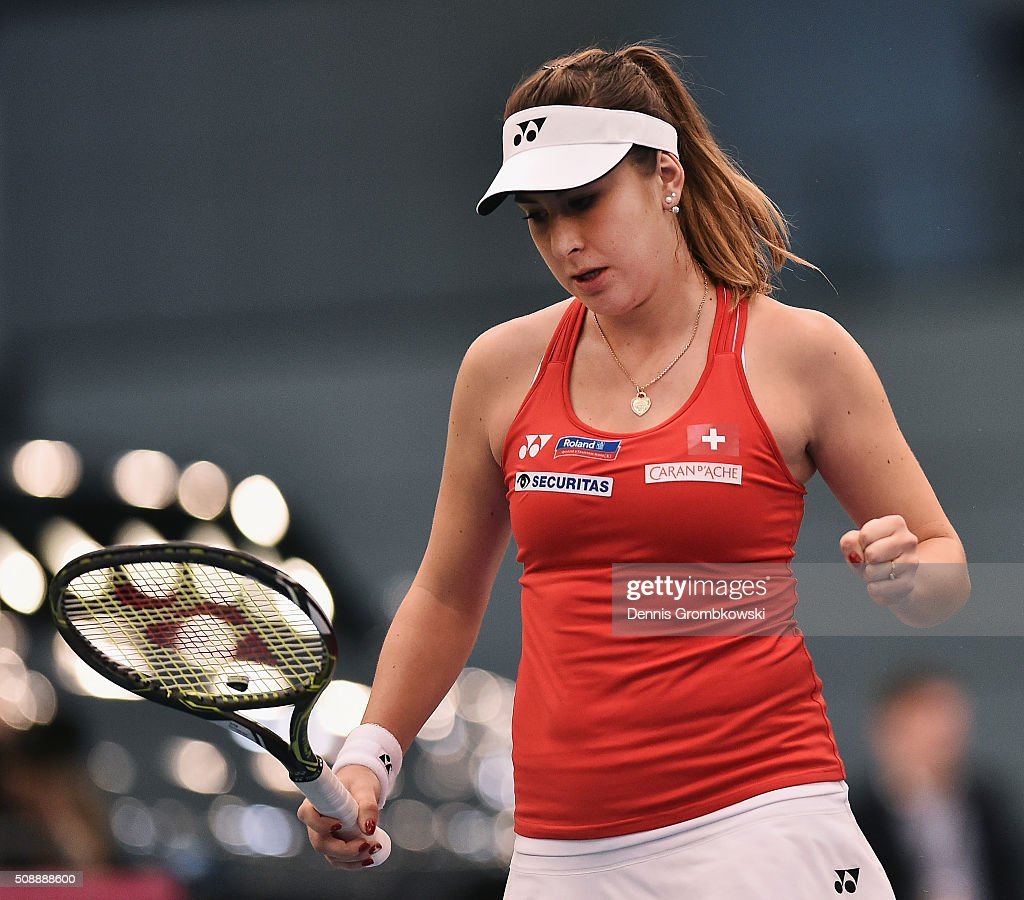 <a gi-track='captionPersonalityLinkClicked' href=/galleries/search?phrase=Belinda+Bencic&family=editorial&specificpeople=8837181 ng-click='$event.stopPropagation()'>Belinda Bencic</a> of Switzerland reacts during her match against Angelique Kerber of Germany on Day 2 of the 2016 FedCup World Group Round 1 match between Germany and Switzerland at Messe Leipzig on February 7, 2016 in Leipzig, Germany.