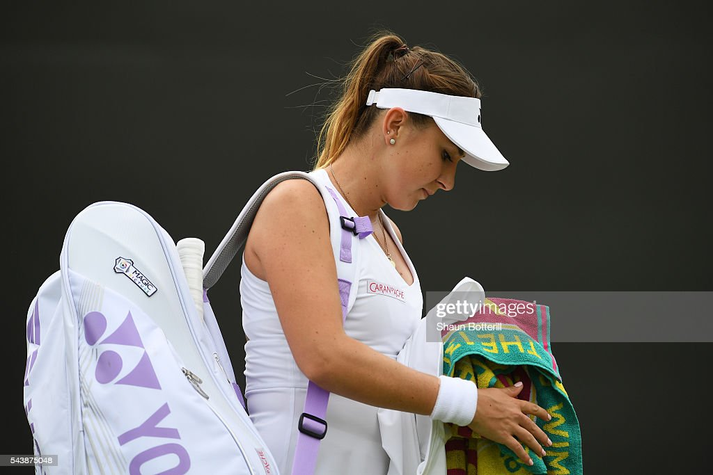 <a gi-track='captionPersonalityLinkClicked' href=/galleries/search?phrase=Belinda+Bencic&family=editorial&specificpeople=8837181 ng-click='$event.stopPropagation()'>Belinda Bencic</a> of Switzerland retires due to an injury during the Ladies Singles second round match against Julia Boserup of the United States on day four of the Wimbledon Lawn Tennis Championships at the All England Lawn Tennis and Croquet Club on June 30, 2016 in London, England.