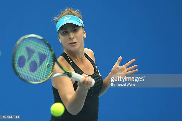 Belinda Bencic of Switzerland returns a ball against Madison Brengle of the United States during the day three of the 2015 China Open at the China...