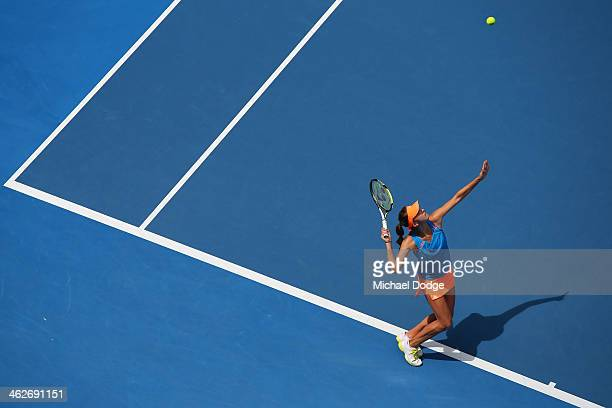 Belinda Bencic of Switzerland serves in her second round match against Na Li of China during day three of the 2014 Australian Open at Melbourne Park...