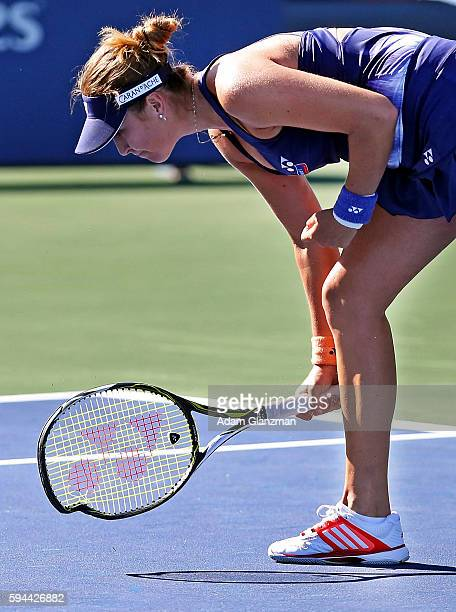 Belinda Bencic of Switzerland smashes her racket during her match against Kirsten Flipkens of Belgium on day 3 of the Connecticut Open at the...