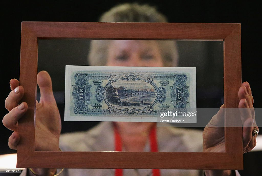 Belinda Downie, CEO of Coinworks holds the first ever banknote of the Commonwealth of Australia as she prepares to put it on display at the World Stamp Expo on May 10, 2013 in Melbourne, Australia. The 'Number One Note' is valued at $AUD 3.5 million and was originally hand numbered at an official ceremony on 1 May 1913 at the Government Printing House in Melbourne. The World Stamp Expo is the largest exhibition of its kind in Australia and the second largest ever held in the world.