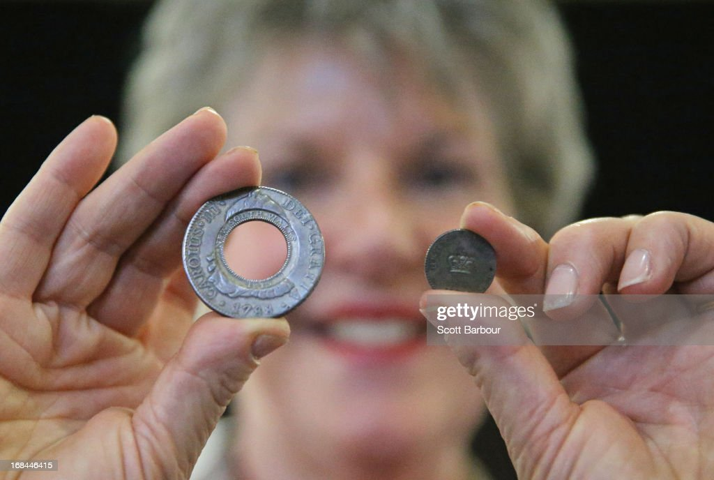 Belinda Downie, CEO of Coinworks holds the Holey Dollar and Dump as she prepares to put them on display at the World Stamp Expo on May 10, 2013 in Melbourne, Australia. The coins are valued at $AUD 80,000 as experts estimate that only 350 Holey dollars and 1500 dumps remain. The World Stamp Expo is the largest exhibition of its kind in Australia and the second largest ever held in the world.