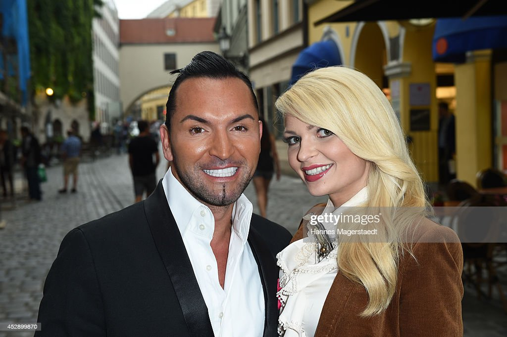 Belinda Gold and Marcus Heinzelmann attend the Marcus Heinzelmann Boutique Opening on July 29, 2014 in Munich, Germany.
