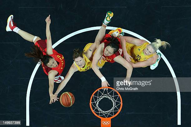 Belinda Snell of Australia shoots under pressure from Zengyu Ma of China and Xiaoli Chen of China while team mate Lauren Jackson of Australia watches...