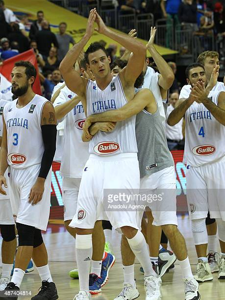 Belinelli and Gallinari celebrate during the FIBA EuroBasket 2015 Group B basketball match between Italy and Germany at Mercedes Benz Arena in Berlin...