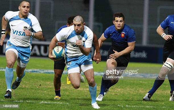 Belisario Agulla of Argentina who scored the first try for his team runs with the during the test match between Argentina Pumas and France at Mario...
