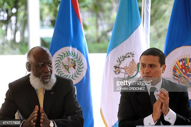 Belize's Foreign Minister Wilfred Elrington and Guatemalan Foreign Minister Carlos Morales applaud during a ceremony to sign an amendment to a...