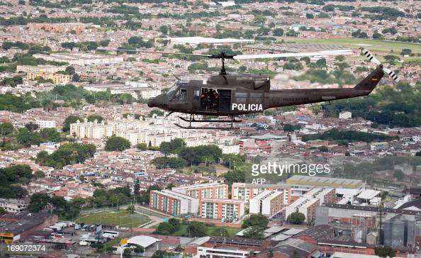A Bell 212 helicopter of the National Police flies over the city of Cali Valle del Cauca departament Colombia on May 19 as part of the security...