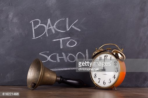Bell and alarm clock against a blackboard : Photo