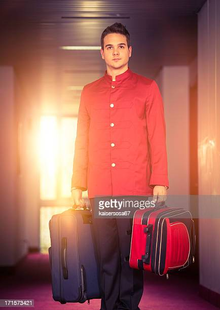 Bell boy carrying luggage