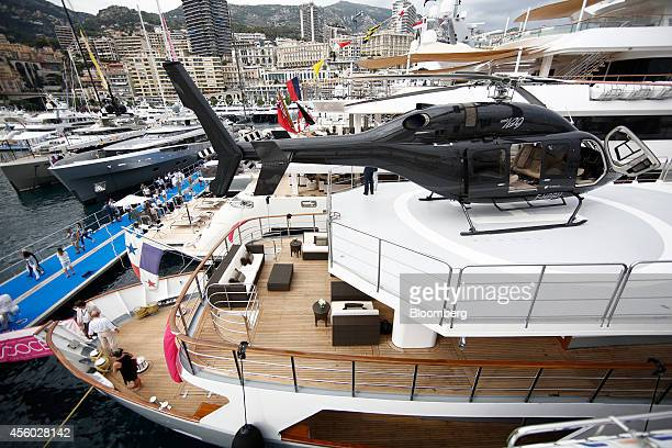 A Bell helicopter manufactured by Textron Inc sits on a helipad on on board the luxury yacht Voyager built by Astilleros Celaya SA and presented by...