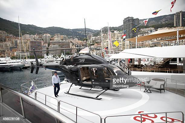 A Bell helicopter manufactured by Textron Inc sits on a helipad on board luxury yacht Voyager built by Astilleros Celaya SA and presented by Ocean...