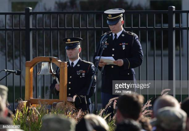A bell is rung as a victim's name is read during an observance to commemorate the anniversary of the 9/11 terror attacks at the Pentagon Memorial...