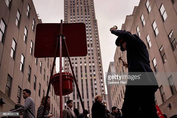 A bell ringer with the Salvation Army dances in midtown on December 17 2014 in New York City Thousands of people have descended onto New York City...