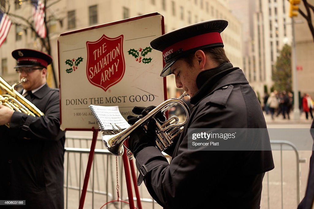 A bell ringer with the Salvation Army plays a trumpet in midtown on December 17 2014 in New York City Thousands of people have descended onto New...
