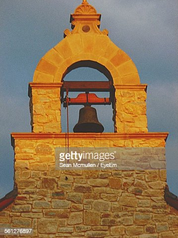 Bell Tower Against Cloudy Sky