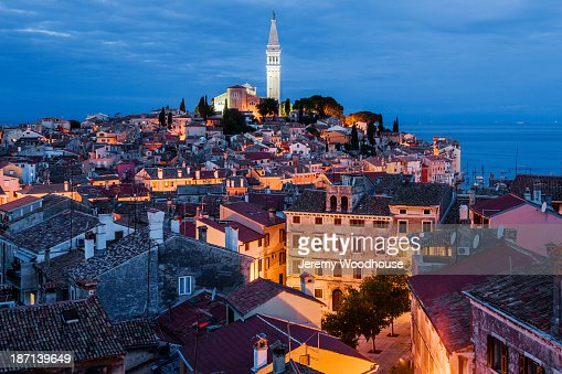 Bell tower and city skyline illuminated at night, Rovinj, Istria, Croatia