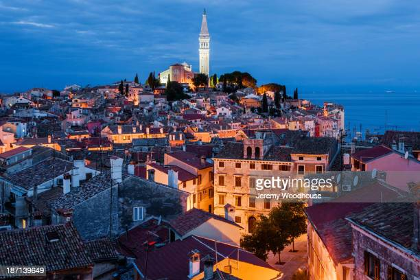 Bell tower and city skyline illuminated at night, Rovinj, Istria, Croatia