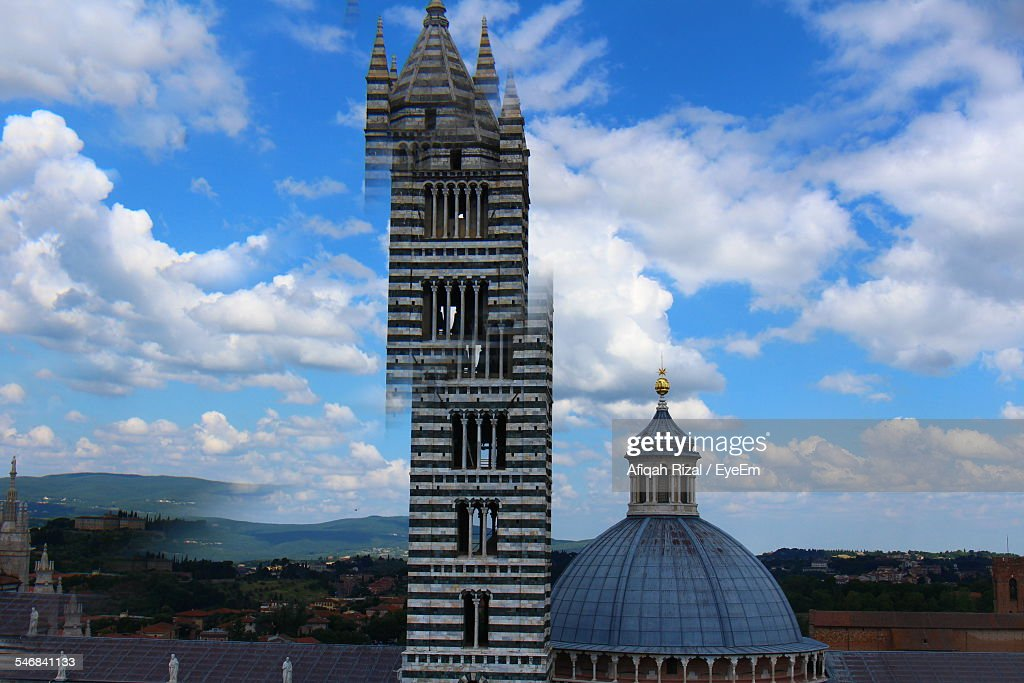 Bell Tower And Dome Of Siena Cathedral Against Sky