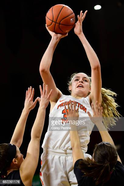 Bella Alarie of the Princeton Tigers shoots over Kelsey Bogdan and Katie Benzan of the Harvard Crimson during the fourth quarter of an Ivy League...