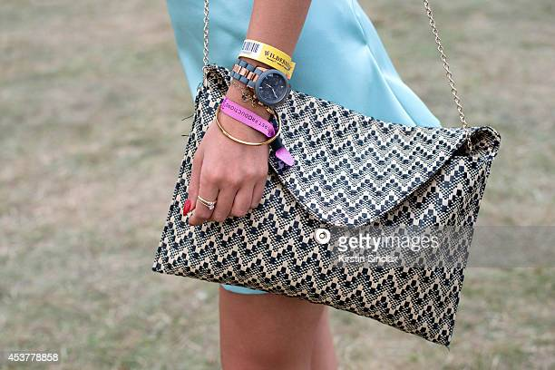 Bella Efthimiou wearing a Topshop skirt and a Primark bag at Wilderness Festival on August 09 2014 in Cornbury Park Oxfordshire England