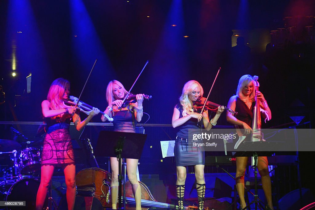 Bella Electric Strings' violinist's Nina DiGregorio, Lydia Ansel, Adrianna Thurber and cellist Ashley Korak perform during 'Mondays Dark With Mark Shunock' benefiting the Miracle League of Las Vegas featuring music from movie soundtracks at the Body English nightclub inside the Hard Rock Hotel & Casino on April 21, 2014 in Las Vegas, Nevada.