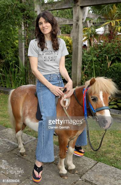 Bella Freud rides Freddie the Shetland pony at the J Brand x Bella Freud garden tea party on July 18 2017 in London England