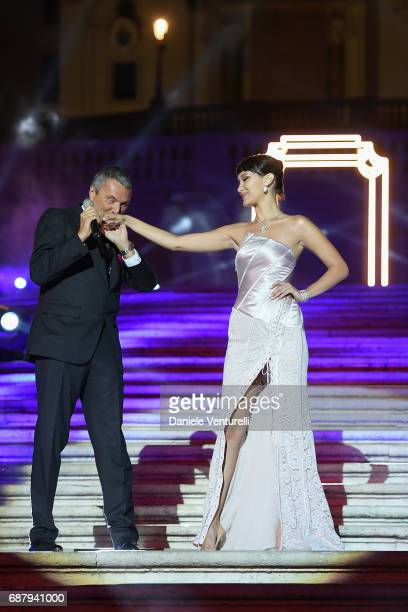 Bella Hadid and Bulgari CEO JeanChristophe Babin attend Goldea The Roman Night Cocktail Dinner on May 24 2017 in Rome Italy