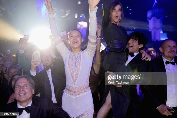 Bella Hadid and Corine Roitfeld attend the amfAR Gala Cannes 2017 at Hotel du CapEdenRoc on May 25 2017 in Cap d'Antibes France
